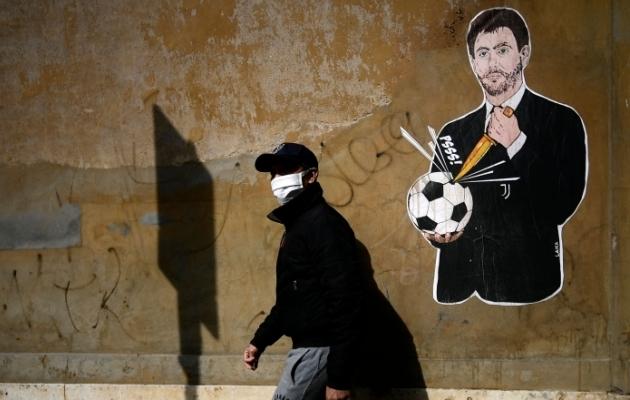 Superliiga idee ühte autorit, Torino Juventuse presidenti Andrea Agnellit tögav grafiti Roomas, Itaalia jalgpalliliidu peakorteri lähedal. Foto: Scanpix / AFP / Filippo Monteforte