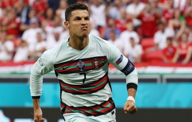 Cristiano Ronaldo sai lõpuks tuusa näo pähe teha. Foto: Scanpix / Bernadett Szabo / Pool via REUTERS